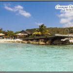 Der Steg von Playa Porto Marie, das Doppelriff in Curacao mit Tauchplatzkarte im Tauchreiseführer